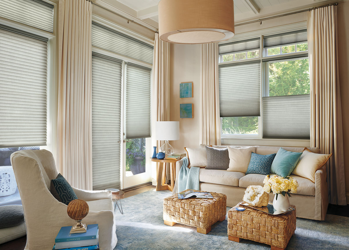 Layered Look: Ceiling-height curtains with honeycomb cellular shades