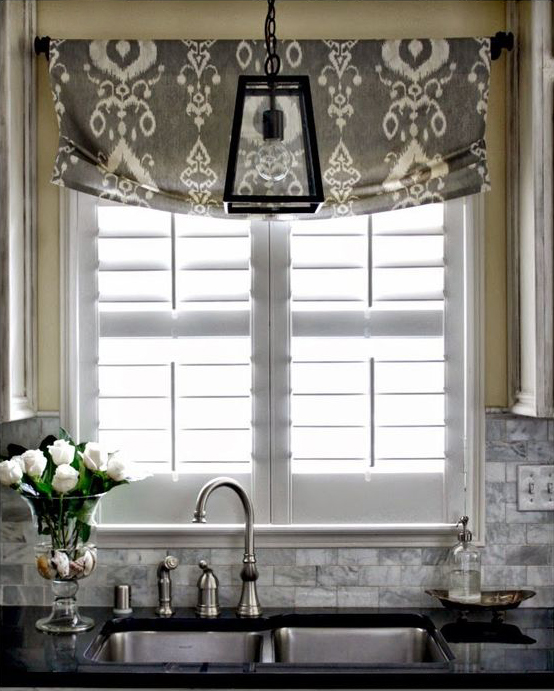 Layered Look: Faux roman shade and plantation shutter combination