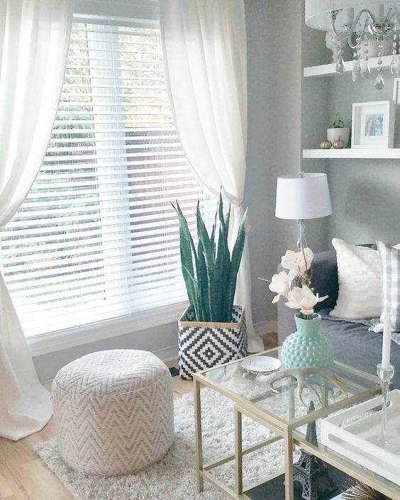 Layered Look: Wood or even faux wood blinds with store-bought curtain panels
