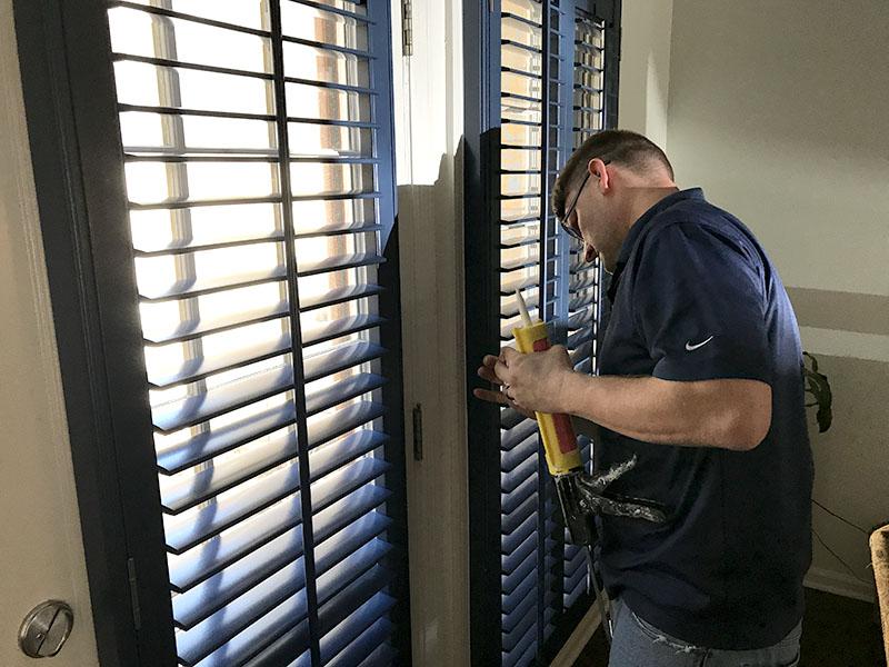 Shutter installation during Cahaba Heights den room transformation